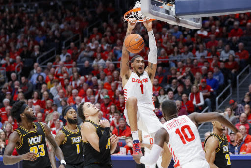Dayton's Obi Toppin (1) dunks as Virginia Commonwealth's Marcus Santos-Silva (14), Mike'L Simms (1) and Issac Vann (23) watch during the second half of an NCAA college basketball game, Tuesday, Jan. 14, 2020, in Dayton, Ohio. (AP Photo/John Minchillo)