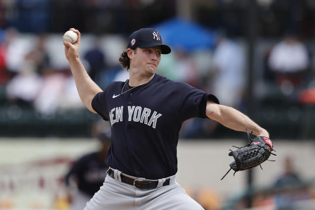 FILE - In this March 5, 2020, file photo, New York Yankees starting pitcher Gerrit Cole throws during a spring training baseball game against the Detroit Tigers in Lakeland, Fla. Due to the coronavirus pandemic, Cole still has not made his regular season debut with the Yankees. (AP Photo/Carlos Osorio, File)