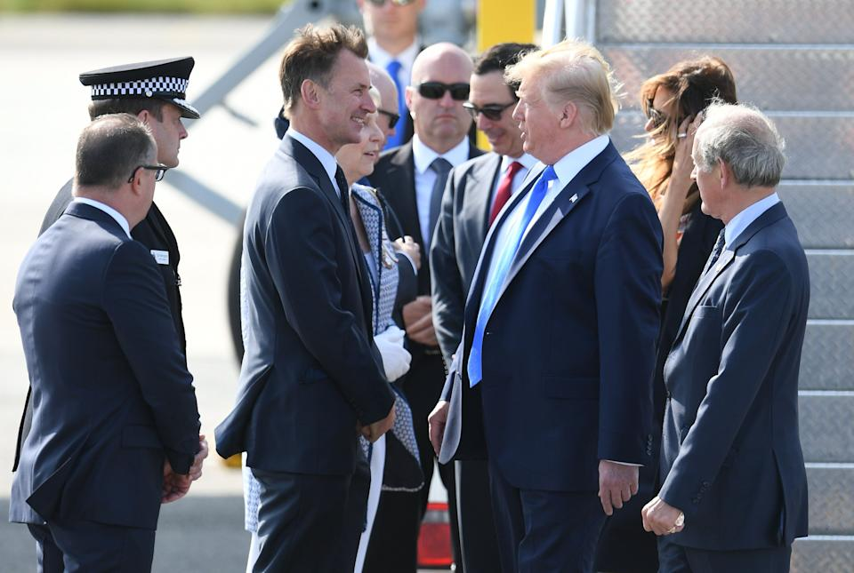 Mr Trump is greeted by foreign secretary Jeremy Hunt (Picture: PA)