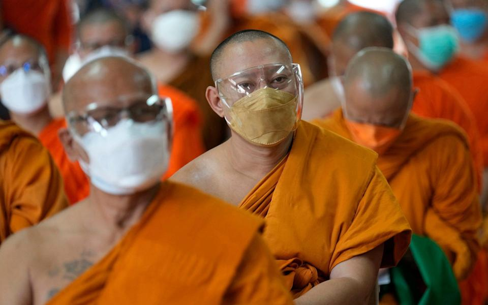 Buddhist monks wait to be vaccinated against Covid-19 in Bangkok, Thailand on 30 July 2021 - Sakchai Lalit/AP