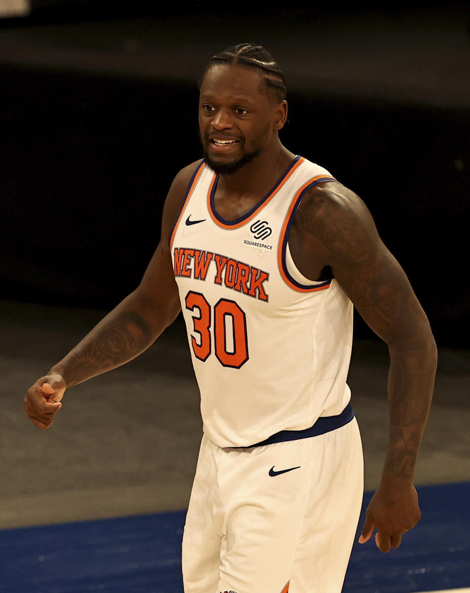 New York Knicks' Julius Randle celebrates his basket in the second half against the Indiana Pacers during an NBA basketball game Saturday, Feb. 27, 2021, in New York. (Elsa/Pool Photo via AP)