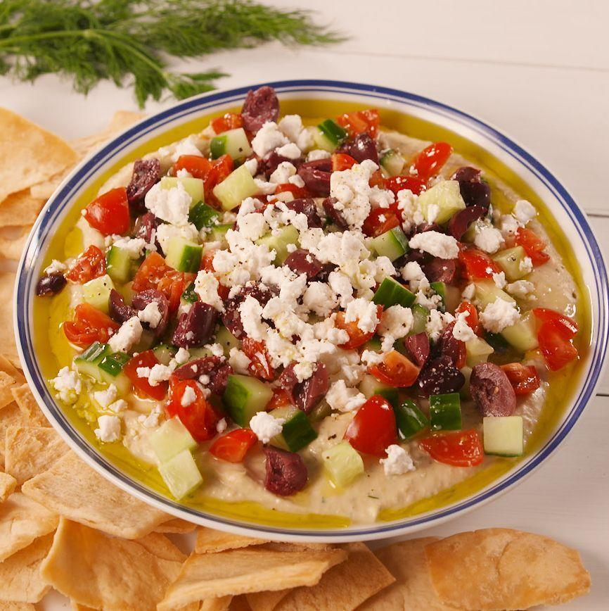"""<p>The perfect party dip.</p><p>Get the <a href=""""https://www.delish.com/uk/cooking/recipes/a34092893/loaded-greek-hummus-recipe/"""" rel=""""nofollow noopener"""" target=""""_blank"""" data-ylk=""""slk:Loaded Greek Hummus"""" class=""""link rapid-noclick-resp"""">Loaded Greek Hummus</a> recipe.</p>"""
