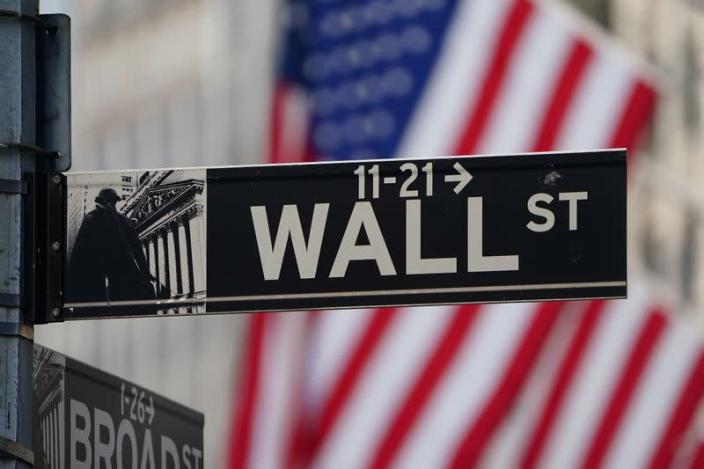 The Wall Street sign is pictured at the New York Stock exchange (NYSE) in the Manhattan borough of New York City