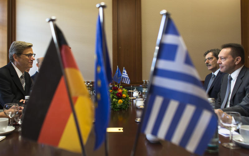 German Foreign Minister Guido Westerwelle, left, talks to his Greek Finance Minister Yiannis Stournaras, right, at a meeting on the financial crisis at the foreign ministry in Berlin, Tuesday, Sept. 4, 2012. (AP Photo/Markus Schreiber)