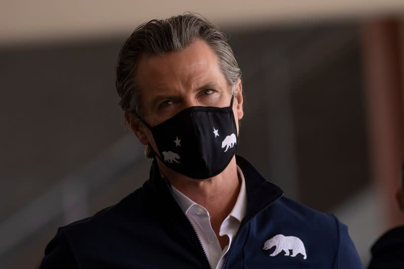 FILE PHOTO: California Governor Gavin Newsom attends opening of new Federal and State run vaccination site in Los Angeles