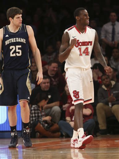 Notre Dame's Tom Knight, left, watches as St. John's Jakarr Sampson reacts after a call during the second half of the NCAA college basketball game, Tuesday, Jan. 15, 2013, at Madison Square Garden in New York. St. John's won 67-63. (AP Photo/Mary Altaffer)