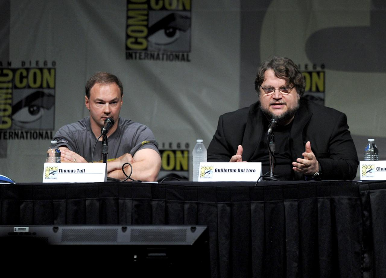 "SAN DIEGO, CA - JULY 14:  Producer Thomas Tull (L) and director Guillermo del Toro speak at Warner Bros. Pictures and Legendary Pictures Preview of ""Pacific Rim"" during Comic-Con International 2012 at San Diego Convention Center on July 14, 2012 in San Diego, California.  (Photo by Kevin Winter/Getty Images)"
