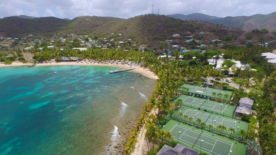"""<p><a href=""""https://curtainbluff.com/"""" rel=""""nofollow noopener"""" target=""""_blank"""" data-ylk=""""slk:Curtain Bluff"""" class=""""link rapid-noclick-resp"""">Curtain Bluff </a>offers all the ease of an all-inclusive resort with the grace of the beach clubs of a bygone era. A staple resort on the island, Curtain Bluff features elegant beachfront rooms along with well-appointed suites that can be rented out by floor to keep the family close by.</p><p>The resort boasts two private beaches, state-of-the-art wellness facilities, tennis courts with ocean views and much more. Plus, there's plenty of opportunity for adventure on land and sea through the Cee Bee Kids' Club for children aged 3-10 to get the true island experience. </p>"""