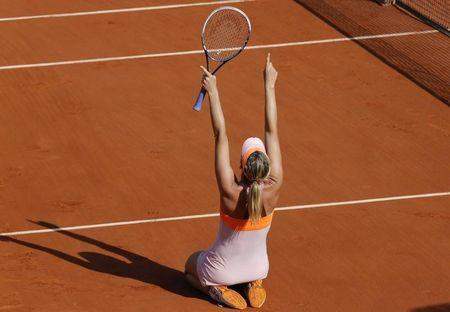 Maria Sharapova of Russia celebrates after winning her women's singles final match against Simona Halep of Romania at the French Open tennis tournament at the Roland Garros stadium in Paris June 7, 2014. REUTERS/Jean-Paul Pelissier