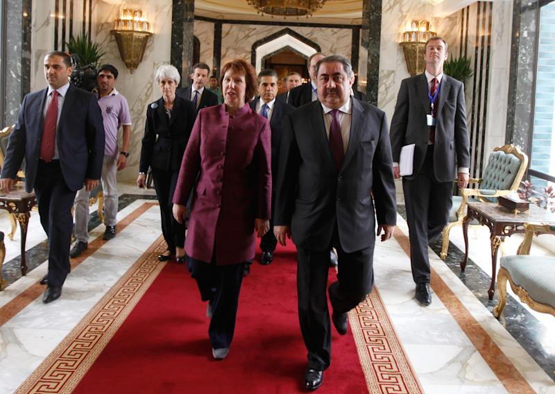 Iraq's Foreign Minister Hoshyar Zebari, 2nd right, walks with the EU foreign policy chief Catherine Ashton upon her arrival at Baghdad International Airport in Iraq, Wednesday, May 23, 2012. Negotiators from the U.S. and five other world powers sat down Wednesday with a team of Iranian diplomats to try to hammer out specific goals in the years-long impasse over Tehran's nuclear program.(AP Photo/Mohammed Ameen, Pool)