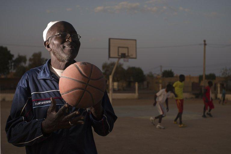 """Basketball coach Oumar Tonko Cisse, 60, pictured during a training session with local youngsters at the former """"Sharia Square"""" in central Gao, on February 26, 2013. Since the departure of the Islamists, who occupied the city for nine months, following the arrival of the French and Malian forces, the central square of Gao is once again called """"Independence square."""""""