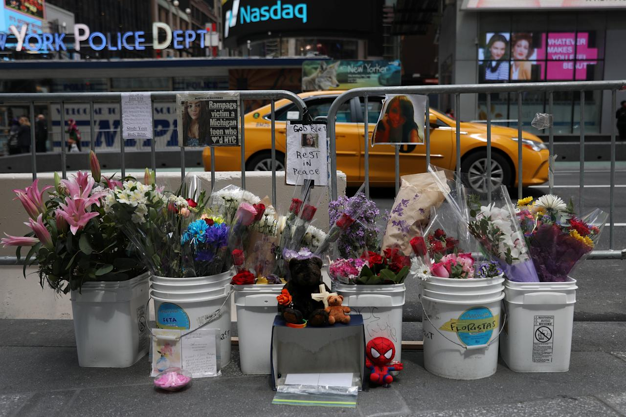 A taxi drives by a memorial created in Times Square for Alyssa Elsman in New York City, New York, U.S., May 24, 2017. REUTERS/Shannon Stapleton