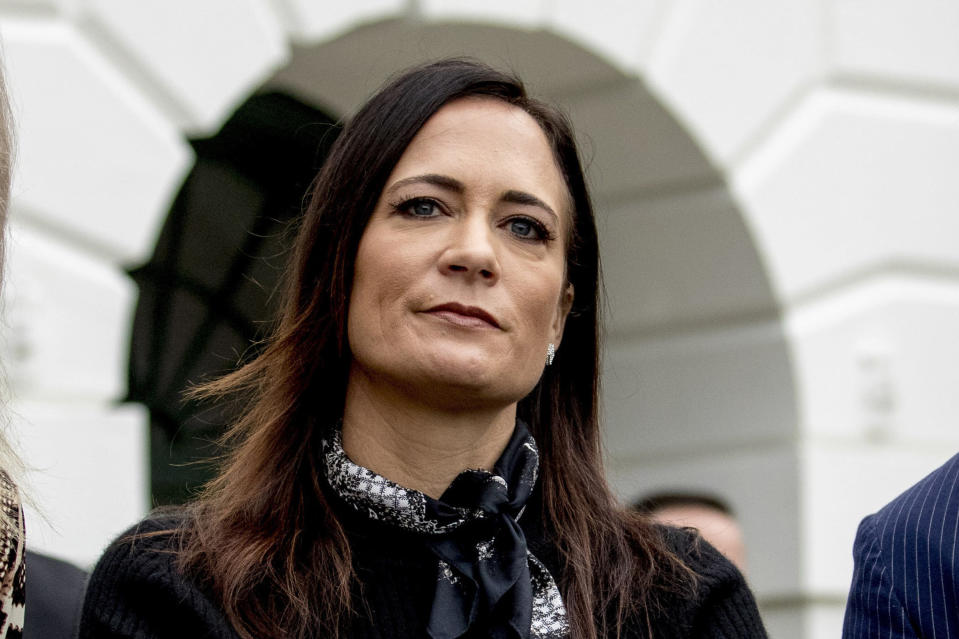 """FILE - In this Oct. 3, 2019, file photo, then White House press secretary Stephanie Grisham listens as President Donald Trump speaks to the media on the South Lawn of the White House in Washington. Republican Max Miller, a candidate for Ohio's 16th House District, filed a defamation lawsuit against Grisham in a court in Cleveland on Tuesday, Oct. 5, 2021, over allegations of physical abuse Grisham is leveling while promoting her new book, """"I'll Take Your Questions Now: What I Saw at the Trump White House."""" (AP Photo/Andrew Harnik, File)"""
