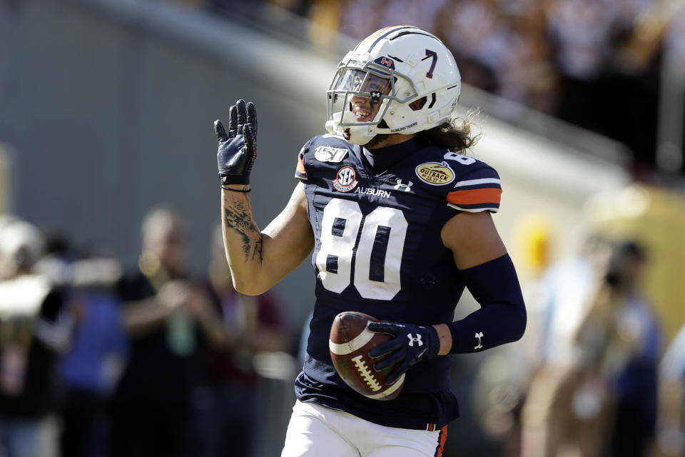 Auburn wide receiver Sal Cannella (80) celebrates after his 37-yard touchdown reception during the first half of the Outback Bowl NCAA college football game against Minnesota Wednesday, Jan. 1, 2020, in Tampa, Fla. (AP Photo/Chris O'Meara)