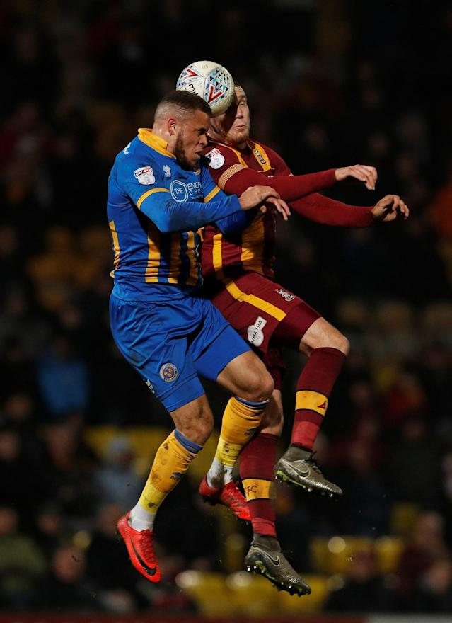 "Soccer Football - League One - Bradford City vs Shrewsbury Town - Northern Commercials Stadium, Bradford, Britain - April 12, 2018 Shrewsbury Town's Carlton Morris in action with Bradford City's Charlie Wyke Action Images/Lee Smith EDITORIAL USE ONLY. No use with unauthorized audio, video, data, fixture lists, club/league logos or ""live"" services. Online in-match use limited to 75 images, no video emulation. No use in betting, games or single club/league/player publications. Please contact your account representative for further details."