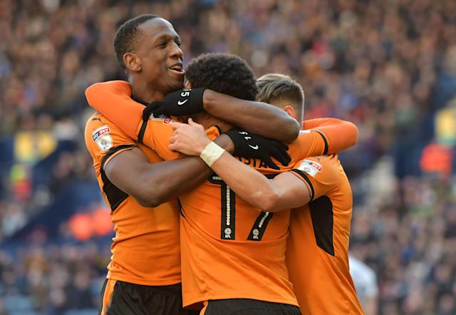 "Soccer Football - Championship - Preston North End vs Wolverhampton Wanderers - Deepdale, Preston, Britain - February 17, 2018 Wolverhampton Wanderers' Helder Costa celebrates with Willy Boly after scoring their first goal Action Images/Paul Burrows EDITORIAL USE ONLY. No use with unauthorized audio, video, data, fixture lists, club/league logos or ""live"" services. Online in-match use limited to 75 images, no video emulation. No use in betting, games or single club/league/player publications. Please contact your account representative for further details."