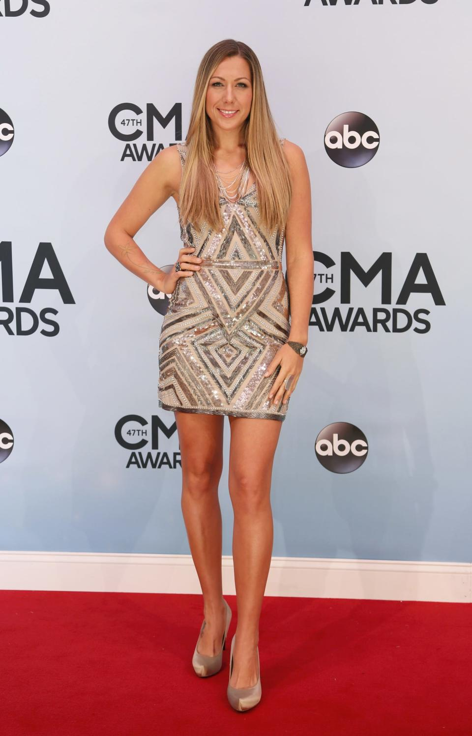 Singer Colbie Caillat arrives at the 47th Country Music Association Awards in Nashville, Tennessee November 6, 2013. REUTERS/Eric Henderson (UNITED STATES - Tags: ENTERTAINMENT)