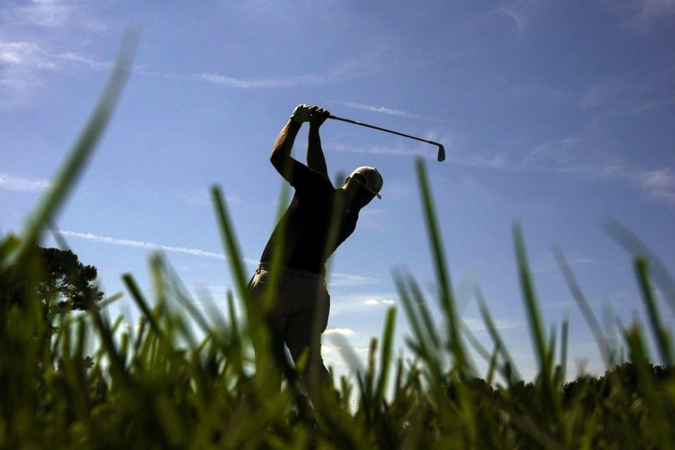 Jon Rahm of Spain, hits from the third tee during the third round of the Tour Championship golf tournament Saturday, Sept. 4, 2021, at East Lake Golf Club in Atlanta. (AP Photo/Brynn Anderson)
