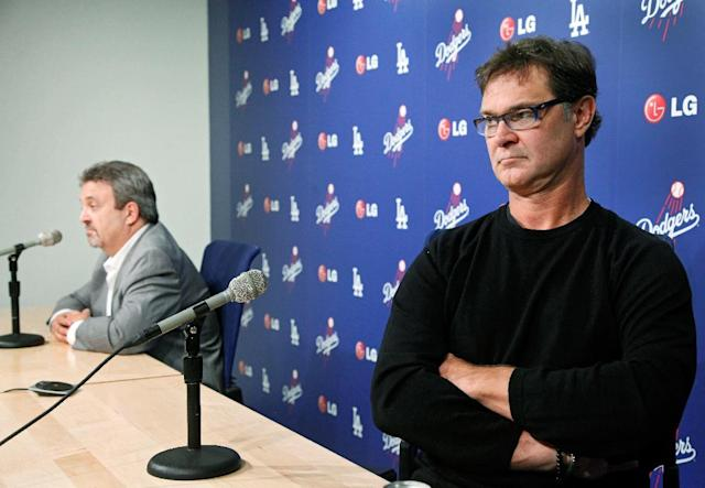Los Angeles Dodgers General Manager Ned Colletti, left, and Dodgers Manager Don Mattingly speak to the media at Dodger Stadium in Los Angeles on Monday, Oct. 21, 2013. (AP Photo/Nick Ut)