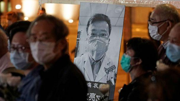 PHOTO: In this file photo taken on Feb. 7, 2020, people wearing masks attend a vigil for Chinese doctor Li Wenliang, who was reprimanded for warning about the outbreak of the novel coronavirus and later died from the disease, in Hong Kong. (Kin Cheung/AP)