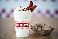 """<p><strong>Official Menu Description: """"</strong>Hand spun vanilla milkshakes with or without whipped cream."""" - <a href=""""https://www.fiveguys.com/"""" rel=""""nofollow noopener"""" target=""""_blank"""" data-ylk=""""slk:Five Guys"""" class=""""link rapid-noclick-resp"""">Five Guys </a></p><p><strong>Verdict:</strong> The best thing about these shakes from Five Guys are all the different mix-ins you can add alongside the hand spun vanilla. Bacon, bananas, cherries, chocolate, coffee, malted milk, oreo cookie pieces, peanut butter, salted caramel and strawberries offer you the chance to make a shake that's completely your own. The base flavor vanilla is just average, but the toppings make this shake really shine.</p>"""