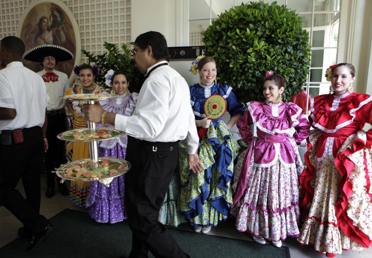Dancers from Ballet Folklorico Mexicano de Georgetown gather to perform at a Cinco de Mayo reception at the White House, May 3.