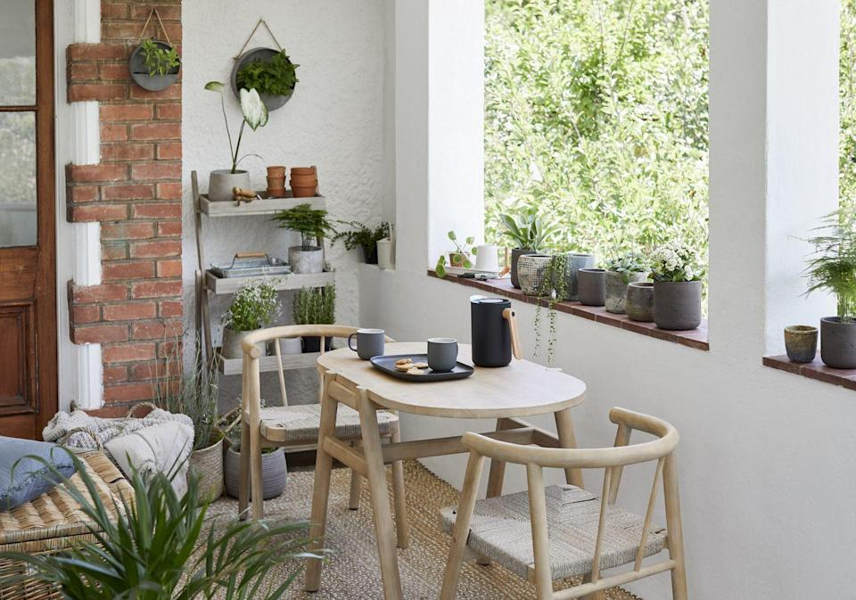 """<p>Give your <a href=""""https://www.housebeautiful.com/uk/garden/designs/how-to/a781/balcony-garden-guide/"""" rel=""""nofollow noopener"""" target=""""_blank"""" data-ylk=""""slk:balcony"""" class=""""link rapid-noclick-resp"""">balcony</a> or <a href=""""https://www.housebeautiful.com/uk/garden/designs/how-to/a782/small-garden-guide/"""" rel=""""nofollow noopener"""" target=""""_blank"""" data-ylk=""""slk:small garden"""" class=""""link rapid-noclick-resp"""">small garden</a> the love it deserves with this stylish Scandi-style dining set. Excellent for small spaces, the chairs can be pushed underneath the table when not in use.</p><p><a class=""""link rapid-noclick-resp"""" href=""""https://go.redirectingat.com?id=127X1599956&url=https%3A%2F%2Fwww.johnlewis.com%2Fjohn-lewis-partners-tuck-2-seater-garden-dining-table-chairs-set-fsc-certified-acacia-wood-natural%2Fp5296315&sref=https%3A%2F%2Fwww.redonline.co.uk%2Finteriors%2Fhomeware%2Fg36003381%2Fjohn-lewis-garden-collection-spring-summer%2F"""" rel=""""nofollow noopener"""" target=""""_blank"""" data-ylk=""""slk:SHOP NOW"""">SHOP NOW</a></p>"""