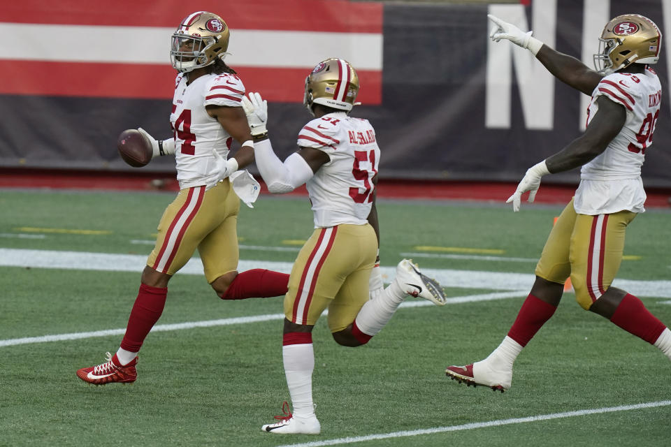 San Francisco 49ers linebacker Fred Warner, left, celebrates his interception with teammates in the first half of an NFL football game against the New England Patriots, Sunday, Oct. 25, 2020, in Foxborough, Mass. (AP Photo/Steven Senne)