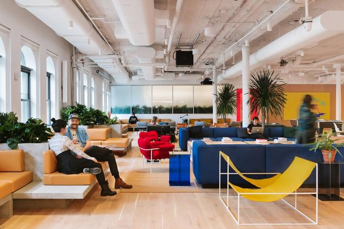 WeWork shared workspace filled with couches and whimsical furniture