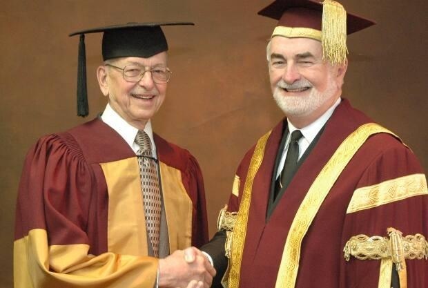 Dr. Ronald Bayne poses with then McMaster University president Peter George May in 2006.