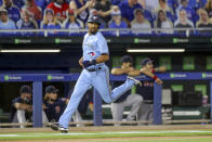 Toronto Blue Jays' Marcus Semien heads home to score against the Boston Red Sox during the fourth inning of a baseball game Tuesday, May 18, 2021, in Dunedin, Fla. (AP Photo/Mike Carlson)