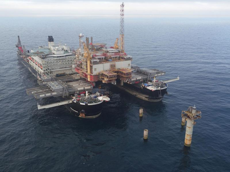 The Pioneering Spirit, the largest ship ever built, shortly after it removed the Norweigan Yme oil rig's topside from its concrete legs. It will soon carry out a similar operation on the much larger, British-owned platform: Kris Scott Hall/Creative Commons