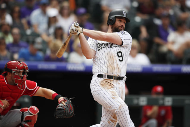 Colorado Rockies' Daniel Murphy connects for a double to drive in two runners off Cincinnati Reds starting pitcher Tyler Mahle in the fifth inning of a baseball game Sunday, July 14, 2019, in Denver.(AP Photo/David Zalubowski)