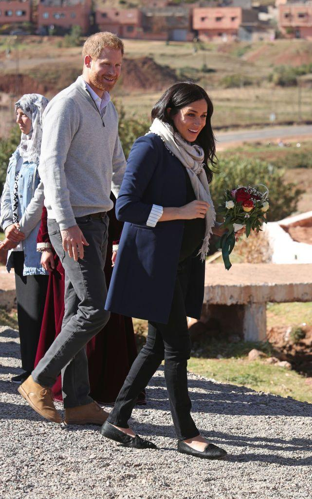 """<p>Meghan and Prince Harry arrived at the Education for All boarding house in the Atlas Mountains. The Duchess kept her look casual wearing black jeans, <a href=""""https://go.redirectingat.com?id=74968X1596630&url=https%3A%2F%2Fwww.shopbop.com%2Fsimpson-roll-cuff-collarless-blazer%2Fvp%2Fv%3D1%2F1502116686.htm&sref=https%3A%2F%2Fwww.townandcountrymag.com%2Fstyle%2Ffashion-trends%2Fg3272%2Fmeghan-markle-preppy-style%2F"""" rel=""""nofollow noopener"""" target=""""_blank"""" data-ylk=""""slk:a navy blazer by Alice and Olivia"""" class=""""link rapid-noclick-resp"""">a navy blazer by Alice and Olivia</a>, her <a href=""""https://www.townandcountrymag.com/style/fashion-trends/g24666108/meghan-markle-birdies-flats-nordstrom/"""" rel=""""nofollow noopener"""" target=""""_blank"""" data-ylk=""""slk:favorite Birdie flats"""" class=""""link rapid-noclick-resp"""">favorite Birdie flats</a>, and an <a href=""""https://www.aritzia.com/us/en/home"""" rel=""""nofollow noopener"""" target=""""_blank"""" data-ylk=""""slk:Aritizia"""" class=""""link rapid-noclick-resp"""">Aritizia</a> scarf, which she later removed. </p><p><a class=""""link rapid-noclick-resp"""" href=""""https://go.redirectingat.com?id=74968X1596630&url=https%3A%2F%2Fwww.shopbop.com%2Fsimpson-roll-cuff-collarless-blazer%2Fvp%2Fv%3D1%2F1502116686.htm&sref=https%3A%2F%2Fwww.townandcountrymag.com%2Fstyle%2Ffashion-trends%2Fg3272%2Fmeghan-markle-preppy-style%2F"""" rel=""""nofollow noopener"""" target=""""_blank"""" data-ylk=""""slk:Shop Now"""">Shop Now</a> <em>Simpson Roll Cuff Collarless Blazer, Alice and Olivia, $485</em></p><p><a class=""""link rapid-noclick-resp"""" href=""""https://go.redirectingat.com?id=74968X1596630&url=https%3A%2F%2Fshop.nordstrom.com%2Fs%2Fbirdies-the-heron-slipper-women%2F5105385&sref=https%3A%2F%2Fwww.townandcountrymag.com%2Fstyle%2Ffashion-trends%2Fg3272%2Fmeghan-markle-preppy-style%2F"""" rel=""""nofollow noopener"""" target=""""_blank"""" data-ylk=""""slk:Shop Now"""">Shop Now</a> <em>The Heron Slipper, Birdies, $120 </em><br></p>"""