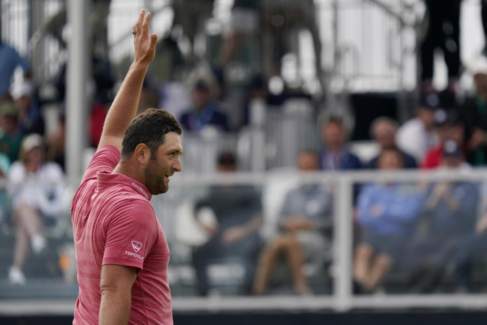 Jon Rahm, of Spain, reacts after making his birdie putt on the 18th green during the final round of the U.S. Open Golf Championship, Sunday, June 20, 2021, at Torrey Pines Golf Course in San Diego. (AP Photo/Gregory Bull)