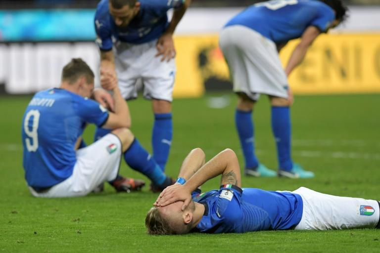 Italian footballers react at the end of their FIFA 2018 World Cup qualification second leg match against Sweden, at the San Siro stadium in Milan, on November 13, 2017