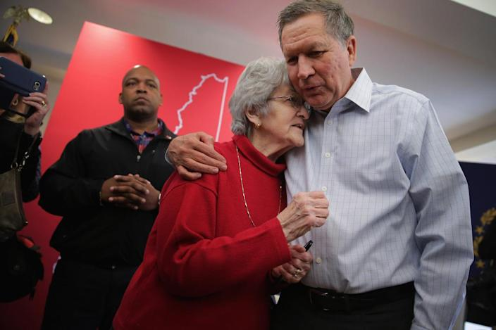 <p>John Kasich embraces a supporter following a town hall meeting at the Portsmouth Country Club, Feb. 1, 2016, in Greenland, N.H. <i> (Photo: Chip Somodevilla/Getty Images)</i></p>