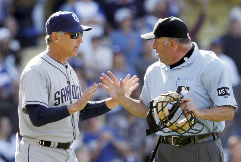 San Diego Padres manager Bud Black, left, argues with plate umpire Dale Scott after the Los Angeles Dodgers turned a triple play in the ninth inning of a baseball game in Los Angeles Sunday, April 15, 2012. Scott ejected Black from the game. The Dodgers won 5-4. (AP Photo/Reed Saxon)