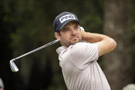 Corey Conners, of Canada, watches his drive down the ninth fairway during the second round of the RBC Heritage golf tournament in Hilton Head Island, S.C., Friday, April 16, 2021. (AP Photo/Stephen B. Morton)