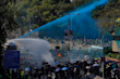 Police spray blue-dyed liquid from an armored vehicle during a confrontation with protestors at the Hong Kong Polytechnic University  (AP)