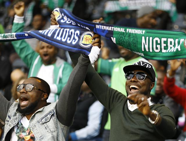 Nigerian fans cheer ahead of the international friendly soccer match between Nigeria and Scotland at Craven Cottage Stadium in London, Wednesday, May 28, 2014. Nigeria will be in Group F in the upcoming World Cup in Brazil . (AP Photo/Kirsty Wigglesworth)