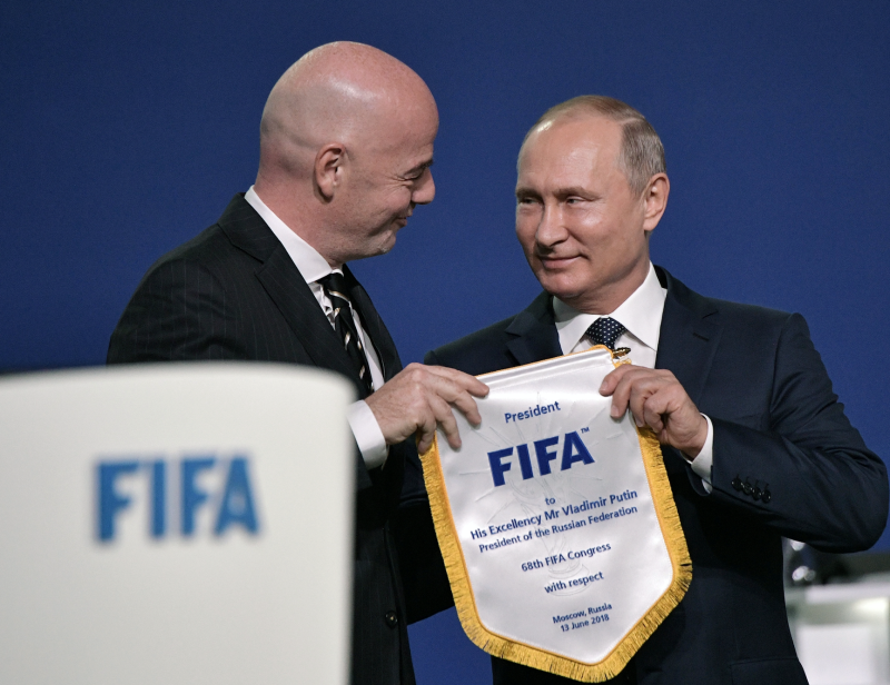 Gianni Infantino, left, and Russian President Vladimir Putin