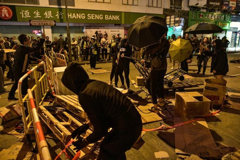 The student helped found a network of volunteer medics to aid the city's pro-democracy protests during the seven months of unrest that has engulfed Hong Kong (AFP Photo/Nicolas ASFOURI)