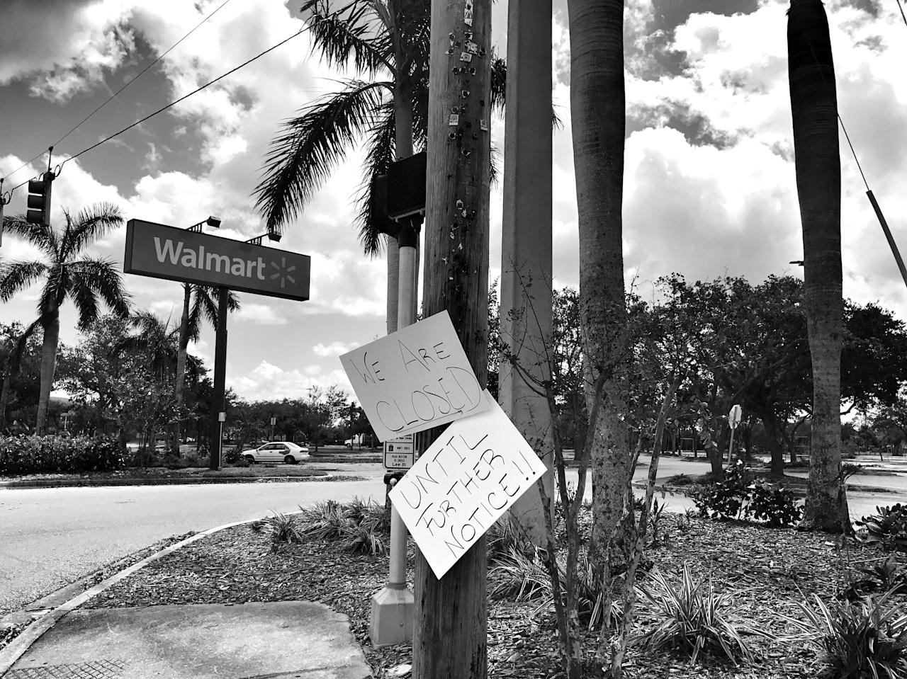 <p>A Walmart store remained closed Tuesday amid widespread power outages in the aftermath of Hurricane Irma in Fort Myers, Fla. (Photo: Holly Bailey/Yahoo News) </p>