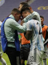 Argentina's Lautaro Martinez celebrates with teammates defeating Colombia in a penalty shootout during a Copa America semifinal soccer match at the National stadium in Brasilia, Brazil, Wednesday, July 7, 2021. (AP Photo/Andre Penner)