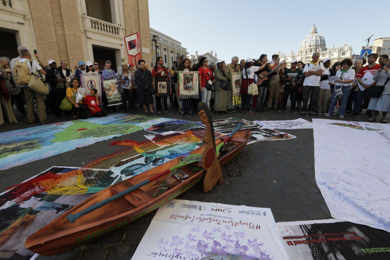 Members of Amazon indigenous populations pray at the end a Via Crucis (Way of the Cross) procession from St. Angelo Castle to the Vatican, Saturday, Oct. 19, 2019. Pope Francis is holding a three-week meeting on preserving the rainforest and ministering to its native people as he fended off attacks from conservatives who are opposed to his ecological agenda. (AP Photo/Andrew Medichini)