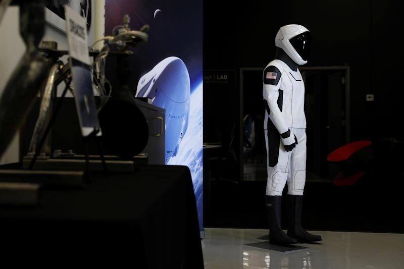 SpaceX shows its new spacesuit that will be worn by NASA astronauts during their first spaceflights in the Crew Dragon spacecraft during a visit to SpaceX headquarters in Hawthorne, California: REUTERS/Mike Blake