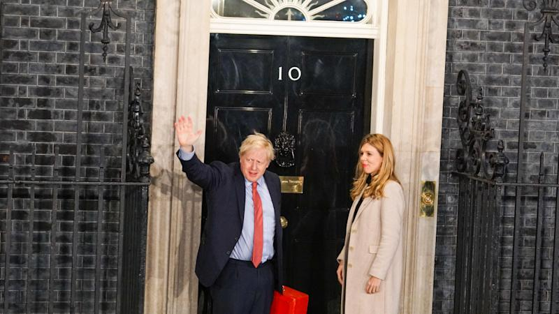 Prime Minister Boris Johnson and his partner Carrie Symonds enter Downing Street as the Conservatives celebrate a sweeping election victory on December 13, 2019 in London, England. (Photo by Giannis Alexopoulos/NurPhoto via Getty Images)
