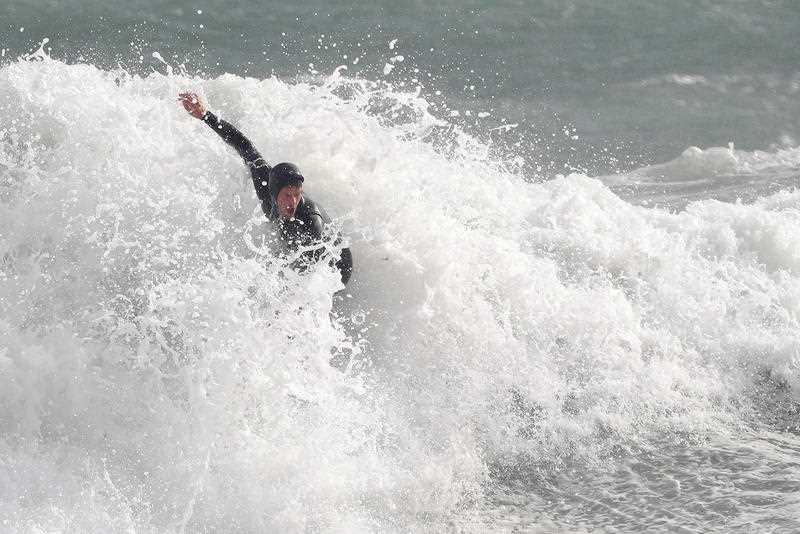 A surfer is seen in action at Cottesloe Beach in Perth.