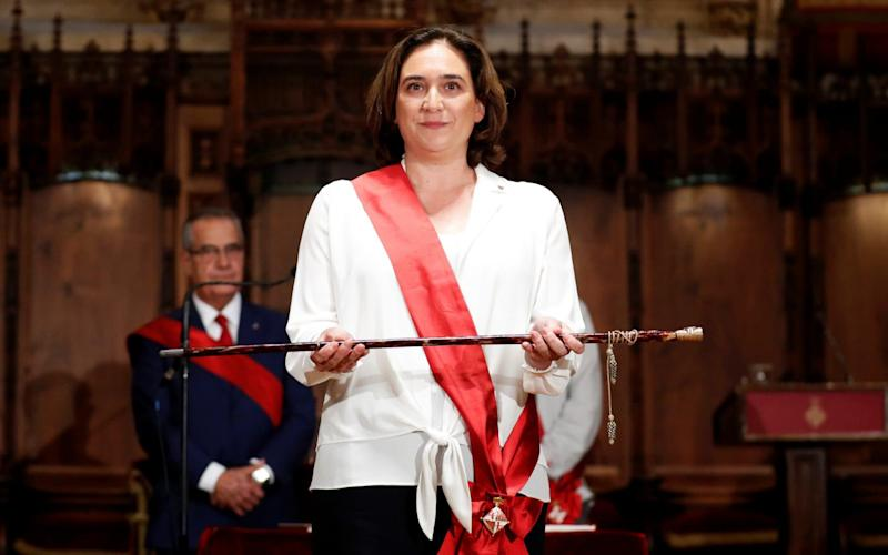 Ada Colau poses during her swearing-in ceremony as the new mayor of Barcelona - REUTERS